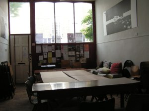 Inside Torriano Meeting House with tables set up for a writing workshop